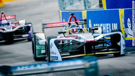 Audi Sport ABT Schaeffler team driver Daniel Abt (C) of Germany takes a corner during the Formula E motor racing championship in Hong Kong on December 2, 2017. / AFP PHOTO / ISAAC LAWRENCE        (Photo credit should read ISAAC LAWRENCE/AFP/Getty Images)