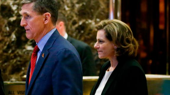 Incoming National Security adviser Lt. Gen. Mike Flynn (C); and KT McFarland (R), incoming deputy national security adviser, walk in the lobby at Trump Tower on December 5, 2016 in New York.