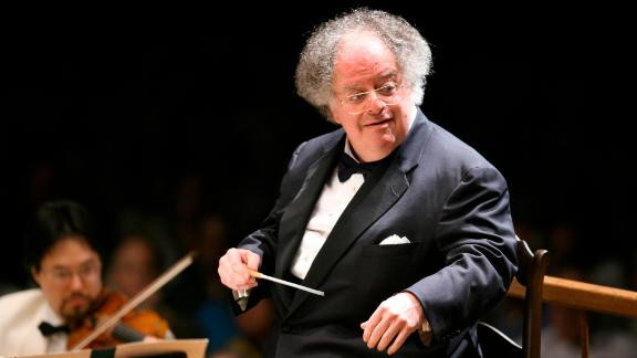 FILE - In this July 7, 2006 file photo, Boston Symphony Orchestra music director James Levine conducts the symphony on its opening night performance at Tanglewood in Lenox., Mass. New York