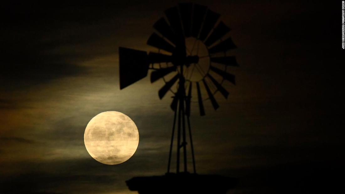 The iconice winidmill in Highlands Ranch, Colorado,  is illuminated by the supermoon. The moon is at its closest point to Earth, making the moon appear up to 14 percent larger and 30 percent brighter than usual.