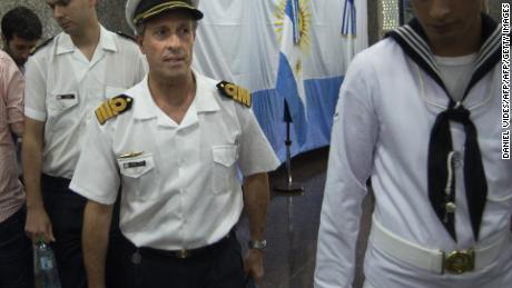 "Picture released by Noticias Argentinas showing Argentine Navy spokesman Captain Enrique Balbi (C), leaving after a press conference during which he announced the end of the SAR (Search and Rescue) operation on the missing ARA San Juan submarine, at the Navy headquarters in Buenos Aires, on November 30, 2017. Argentina's navy formally ended its search for survivors from the San Juan submarine, two weeks after the vessel went missing in the South Atlantic with 44 crew aboard. The navy has shifted its mission from rescue to recovery, Balbi said.  / AFP PHOTO / NOTICIAS ARGENTINAS / DANIEL VIDES / Argentina OUT / RESTRICTED TO EDITORIAL USE - MANDATORY CREDIT ""AFP PHOTO /"" - NO MARKETING NO ADVERTISING CAMPAIGNS - DISTRIBUTED AS A SERVICE TO CLIENTS        (Photo credit should read DANIEL VIDES/AFP/Getty Images)"