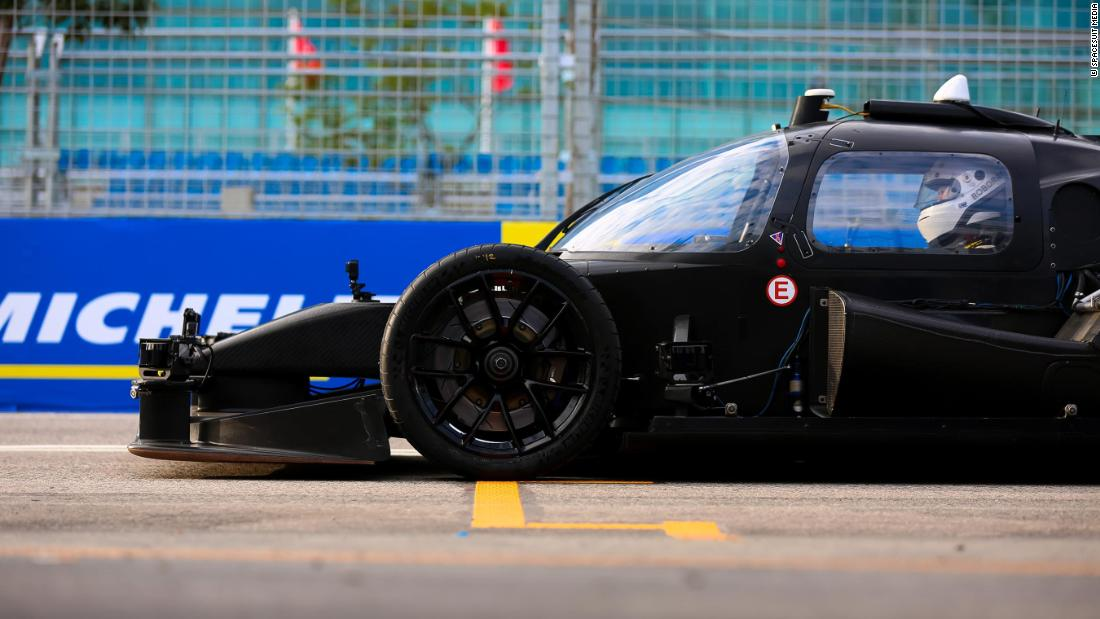 "The ""Human vs. machine"" challenge pitted an autonomous race car against a human driver on a Formula E street circuit around Hong Kong's harborfront."