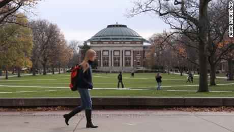 In this Nov. 20, 2015 photo, University of Illinois students walk across the Main Quad on campus in Urbana, Illinois.
