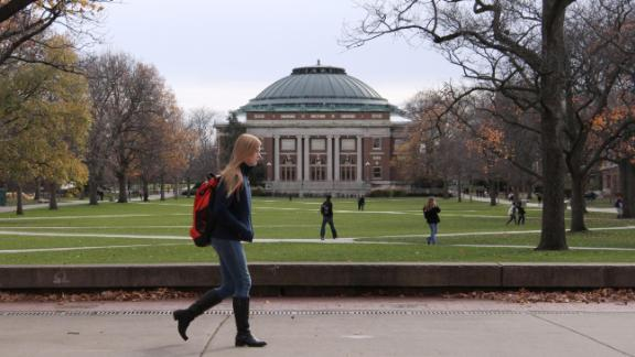 In this Nov. 20, 2015 photo, University of Illinois students walk across the Main Quad on campus in Urbana, Illinois.