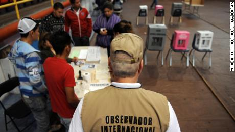 An international observer from Panama checks the voting during general elections in Tegucigalpa, on November 29, 2009. Hondurans vote Sunday for the first time since President Manuel Zelaya was forced out of the country in June, in a tense atmosphere around polls which have divided the Americas. Amid a climate of fear, it was unclear how many of the 4.6 million eligible voters would actually turn out. AFP PHOTO/Yuri Cortez (Photo credit should read YURI CORTEZ/AFP/Getty Images)