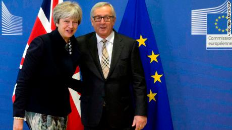 European Commission President Jean-Claude Juncker greets British PM Theresa May prior to a crucial Brexit meeting at EU headquarters in Brussels on Monday.