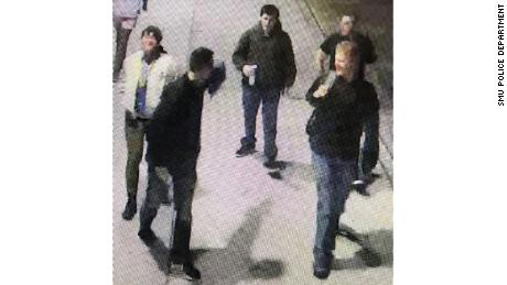 Campus police at Southern Methodist University are asking for the public's help in identifying the five men, seen here in an image from surveillance footage, who posted the flyers over the weekend.