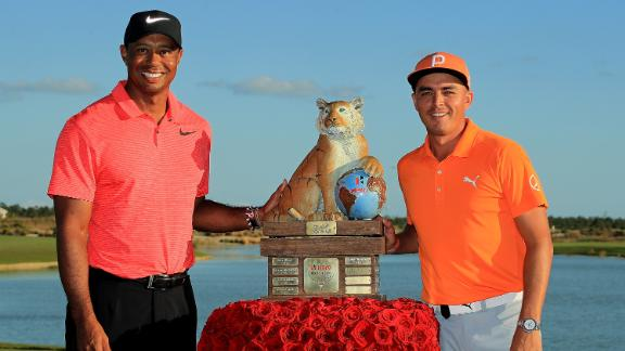 Pretty in pink: Woods made a promising comeback from 10 months out in December but Rickie Fowler received the trophy for winning the Hero World Challenge, which benefits Woods
