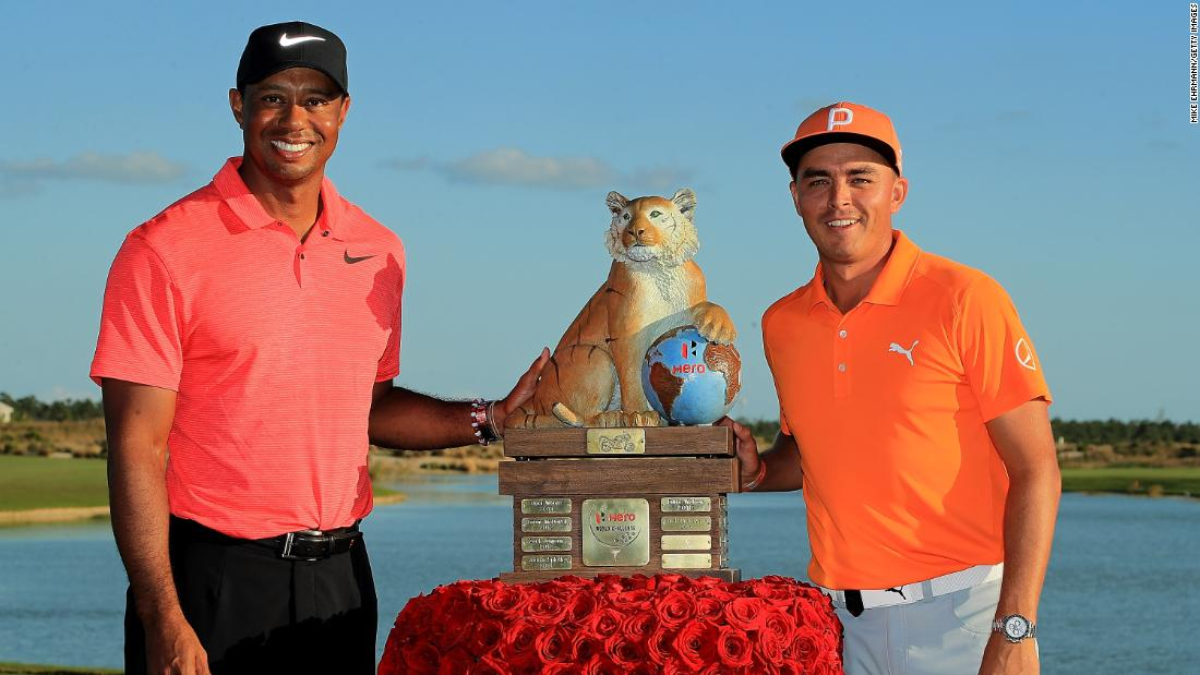 <strong>Pretty in pink:</strong> Woods made a promising comeback from 10 months out in December but Rickie Fowler received the trophy for winning the Hero World Challenge, which benefits Woods' charity.