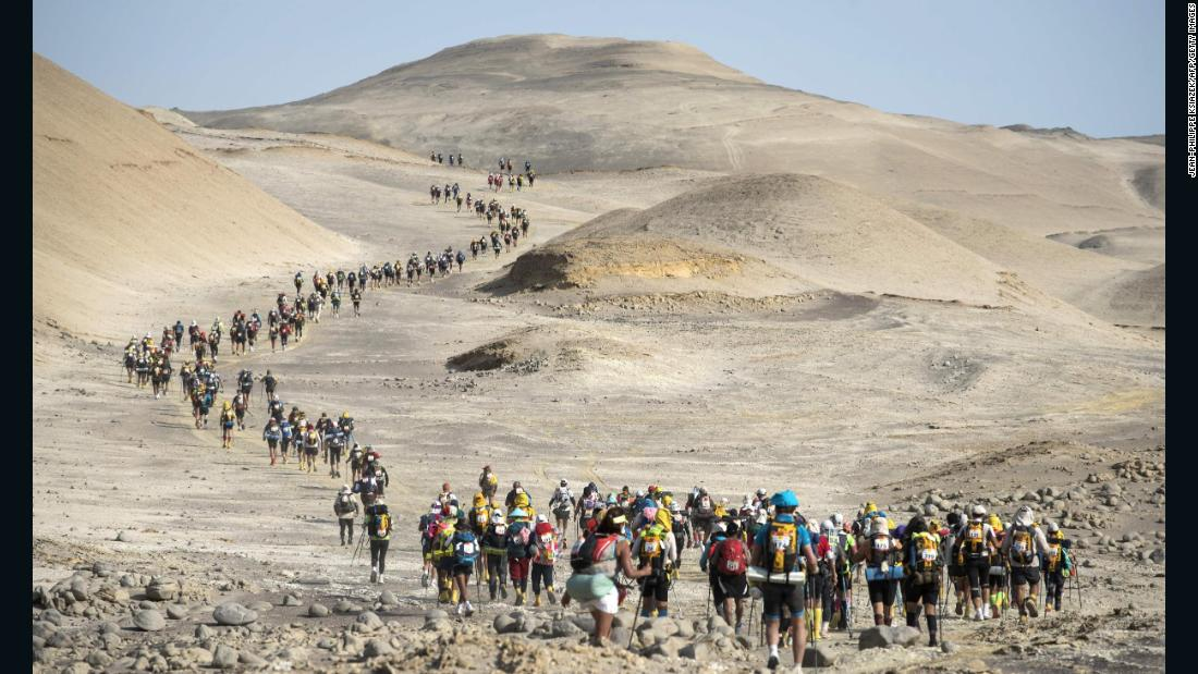 Competitors travel through the Ica desert during Peru's Marathon des Sables on Thursday, November 30. The ultramarathon is divided into six stages and is approximately 250 kilometers (155.34 miles) long.