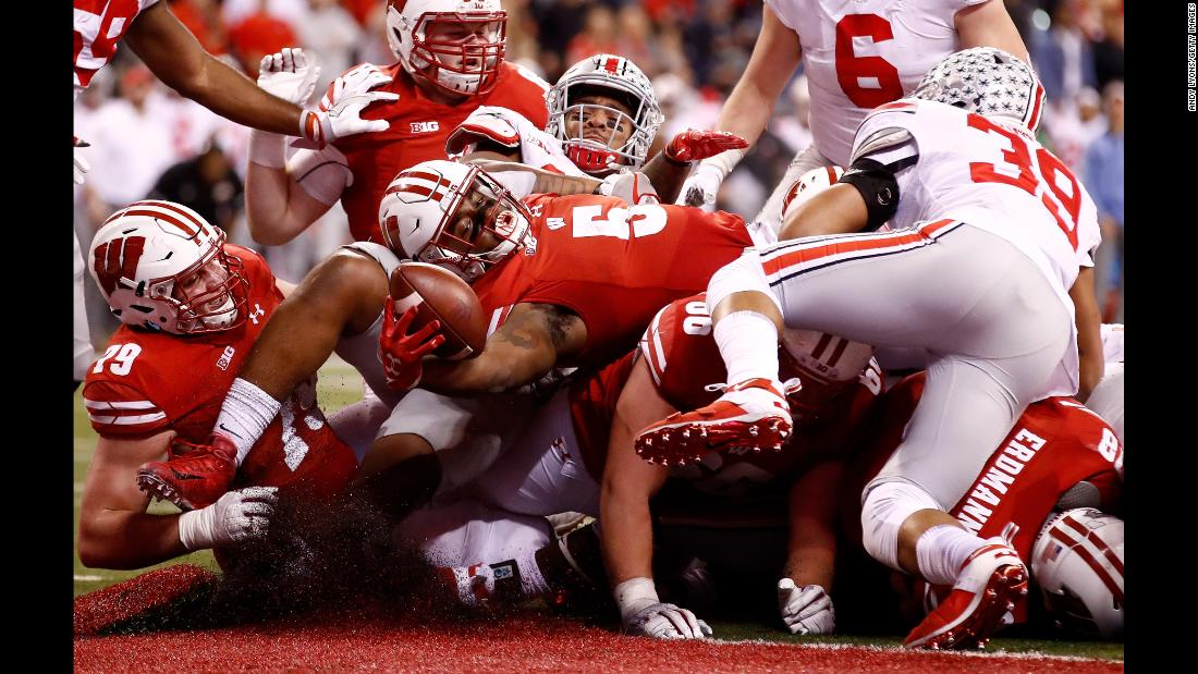 Wisconsin running back Chris James reaches over the pile for a touchdown during the Big Ten Championship on Saturday, December 2. The fourth-quarter score moved the Badgers closer to Ohio State, but they ultimately lost 27-21. It was their first loss of the season.
