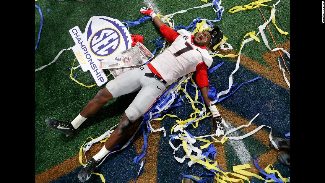 Georgia linebacker Lorenzo Carter celebrates after the Bulldogs defeated Auburn 28-7 to win the SEC title on Saturday, December 2. The next day, Georgia was one of the four teams chosen to play in this season's College Football Playoff.