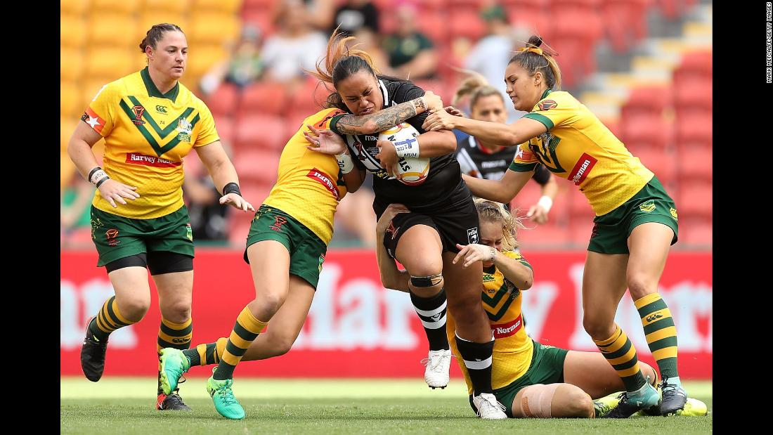 Australian rugby players tackle New Zealand's Lilieta Maumau during the final of the Rugby League World Cup on Saturday, December 2. Australia, the tournament host and defending champion, won 23-16.
