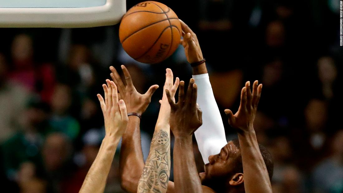Phoenix center Greg Monroe rises above a crowd during an NBA game in Boston on Saturday, December 2.
