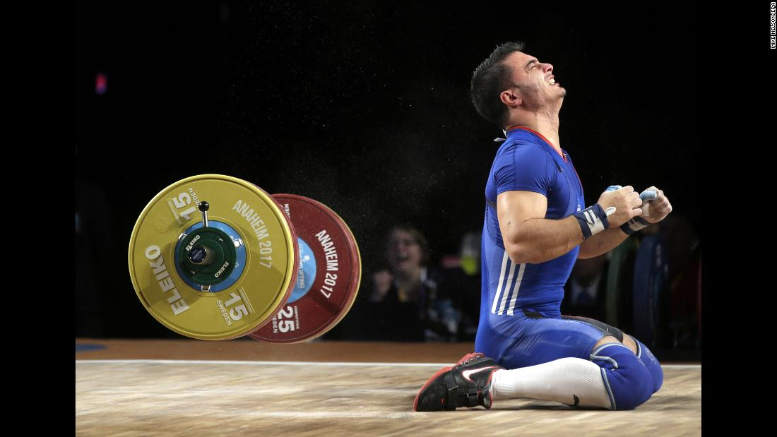 French weightlifter Romain Jordan Sebastian Imadouchine reacts during the Weightlifting World Championships on Sunday, December 3. He won bronze in his weight class' clean-and-jerk category.