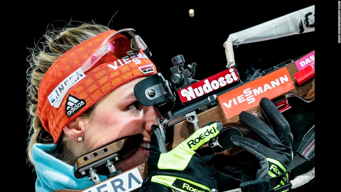 German biathlete Denise Herrmann fires her rifle during a World Cup event in Ostersund, Sweden, on Friday, December 1. She won the 7.5-kilometer sprint competition.