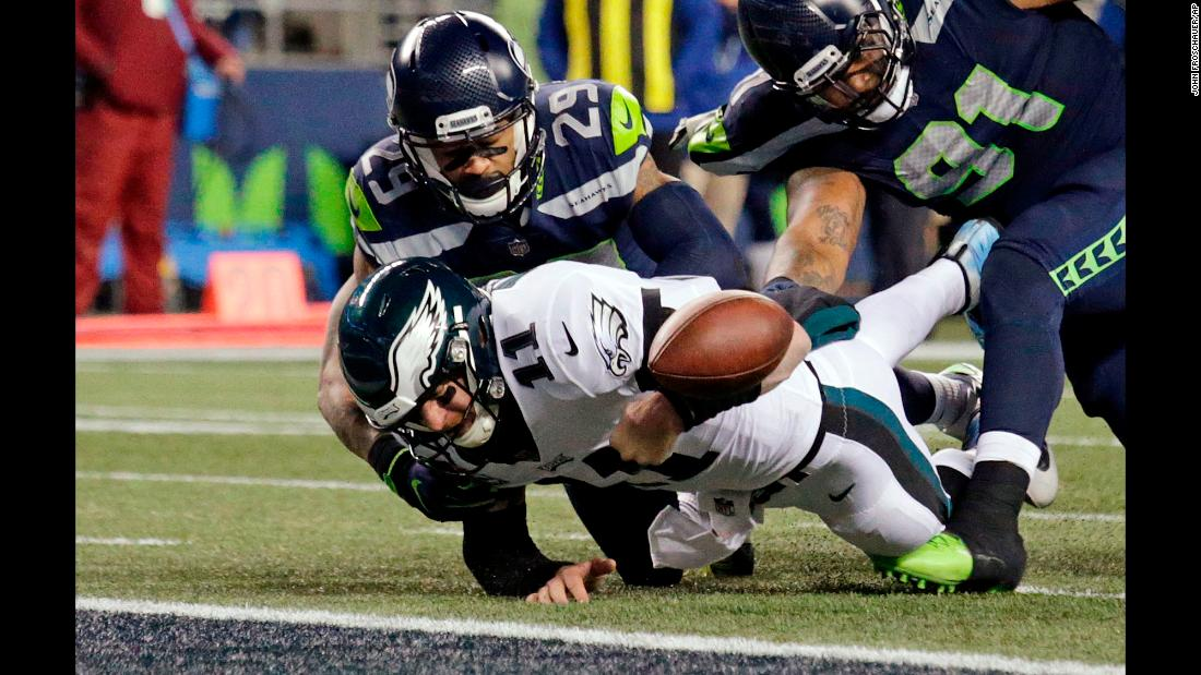 Philadelphia quarterback Carson Wentz fumbles the ball near the goal line during an NFL game in Seattle on Sunday, December 3. Seattle won 24-10, handing the 10-1 Eagles their second loss of the season.