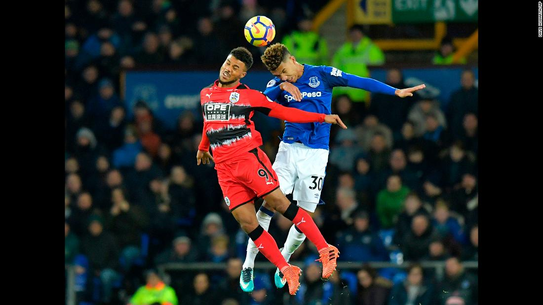 Huddersfield Town's Elias Kachunga, left, and Everton's Mason Holgate jump for<br />a header during a Premier League match in Liverpool, England, on Saturday, December 2.