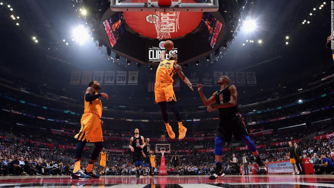 Utah's Donovan Mitchell rises for a dunk during an NBA game in Los Angeles on Thursday, November 30.
