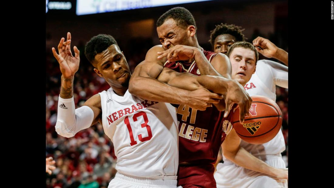 Nebraska's Anton Gill battles for a rebound with Boston College's Steffon Mitchell during a college basketball game on Wednesday, November 29.