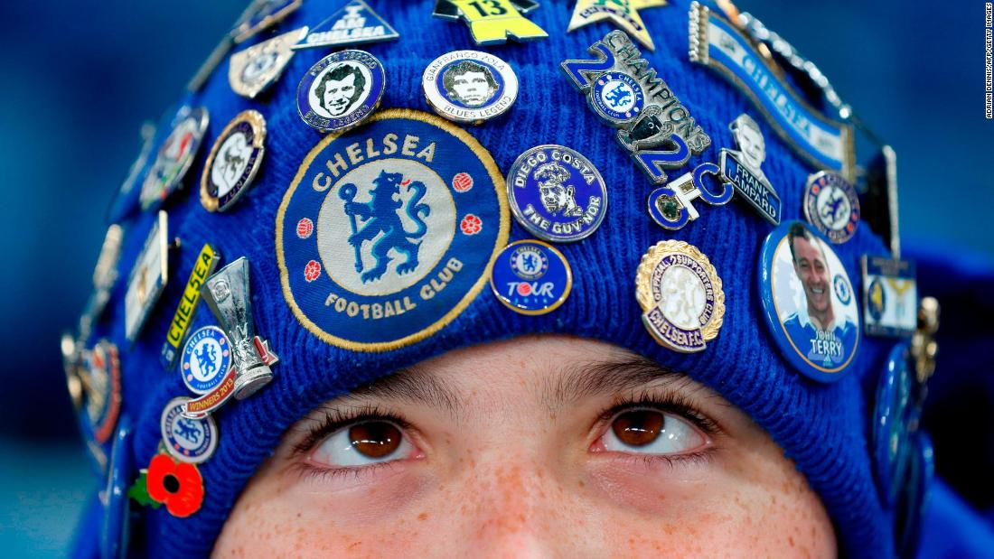 A young Chelsea fan wears a badge-covered hat before a Premier League match in London on Wednesday, November 29.