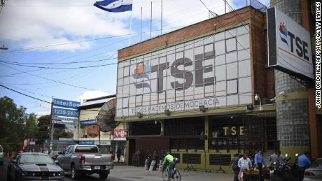 "Outside view of the Honduran Supreme Electoral Tribunal building in Tegucigalpa, on December 4, 2017.  Honduran electoral authorities concluded a recount early Monday, more than a week after a bitterly contested presidential election, that put President Juan Orlando Hernandez in the lead, but they held back from officially declaring him the winner. ""We have now finished this recount,"" Supreme Electoral Tribunal president David Matamoros said, announcing that Hernandez had 42.98 percent of the vote compared with opposition leader Salvador Nasralla's 41.39 percent.  / AFP PHOTO / JOHAN ORDONEZ        (Photo credit should read JOHAN ORDONEZ/AFP/Getty Images)"