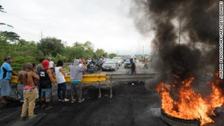 "Supporters of the presidential candidate for Honduras' Opposition Alliance against the Dictatorship, Salvador Nasralla, set fire to a barricade to block the passage between San Pedro Sula and El Progreso, 200 kilometres north of Tegucigalpa, on December 4, 2017. Honduran electoral authorities concluded a recount early Monday, more than a week after a bitterly contested presidential election, that put President Juan Orlando Hernandez in the lead, but they held back from officially declaring him the winner. ""We have now finished this recount,"" Supreme Electoral Tribunal president David Matamoros said, announcing that Hernandez had 42.98 percent of the vote compared with opposition leader Salvador Nasralla's 41.39 percent. / AFP PHOTO / JORDAN PERDOMO        (Photo credit should read JORDAN PERDOMO/AFP/Getty Images)"