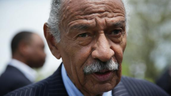 "WASHINGTON, DC - APRIL 22:   U.S. Rep. John Conyers (D-MI) speaks to a reporter at the end of a news conference April 22, 2015 on Capitol Hill in Washington, DC. Rep. Conyers held the news conference to discuss the ""End Racial Profiling Act.""  (Photo by Alex Wong/Getty Images)"