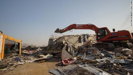 Beijing forces migrant workers from their homes in 'savage' demolitions