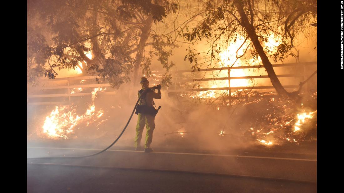 A firefighter works to put out a blaze in Santa Paula early on December 5.