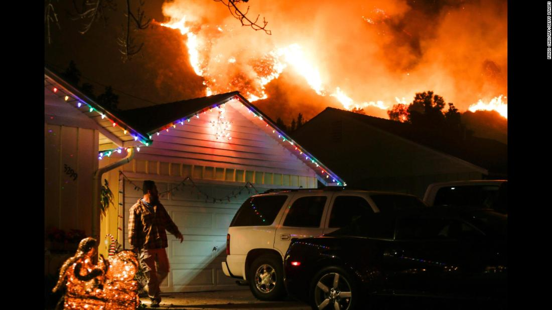 A man prepares to evacuate his Santa Paula home on December 5.