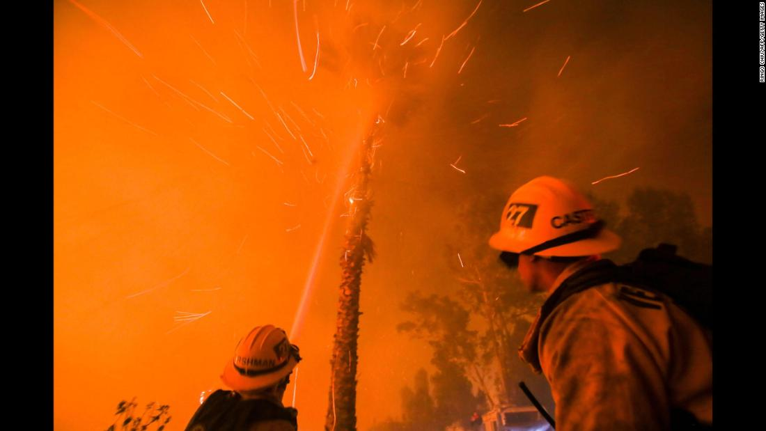 Firefighters battle the fire as it burns near homes in Santa Paula on December 5.