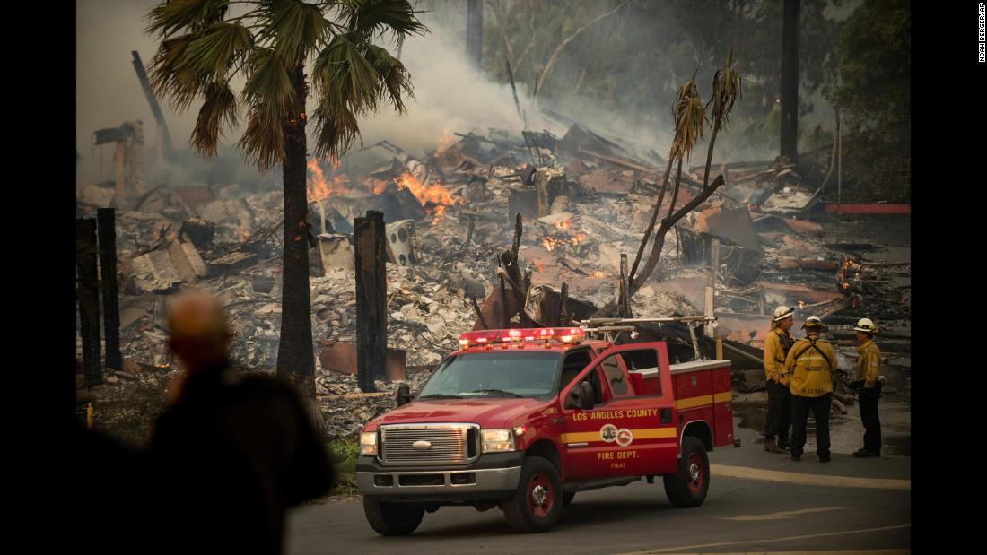 "An apartment complex burns as a wildfire rages in Ventura, California, on Tuesday, December 5. The <a href=""http://www.cnn.com/2017/12/05/us/ventura-county-fire-california/index.html"" target=""_blank"">Thomas Fire</a> started north of Santa Paula, California, on Monday night and has spread into the edges of Ventura, a city of more than 100,000 people situated on the Pacific coast. Dozens of buildings have been destroyed in Ventura County, and thousands of people have had to evacuate their homes."