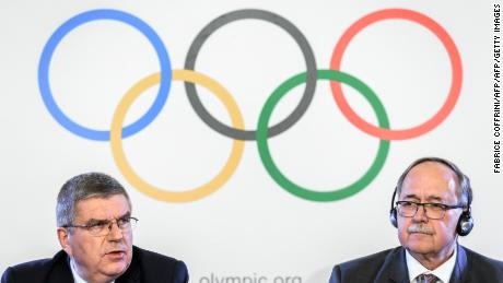 "International Olympic Committee (IOC) President Thomas Bach (L) and Chair of IOC Inquiry Commission into alleged Russian doping at Sochi 2014 Swiss Samuel Schmid attend a press conference following an executive meeting on Russian doping, on December 5, 2017 in Lausanne. Russia were banned from the 2018 Olympics on December 5 over state-sponsored doping but the International Olympic Committee said Russian competitors would be able to compete ""under strict conditions"". / AFP PHOTO / Fabrice COFFRINI        (Photo credit should read FABRICE COFFRINI/AFP/Getty Images)"