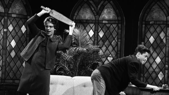 "Catholic schools were known for their knuckle-rapping nuns, administering corporal punishment to any and all educational slackers. In this 1990 skit from NBC's ""Saturday Night Live,"" Dana Carvey's Church Lady takes way too much pleasure in punishing ""schoolboy"" Rob Lowe. Today, most teachers in Catholic schools are not nuns or priests, and most have put the paddle away."