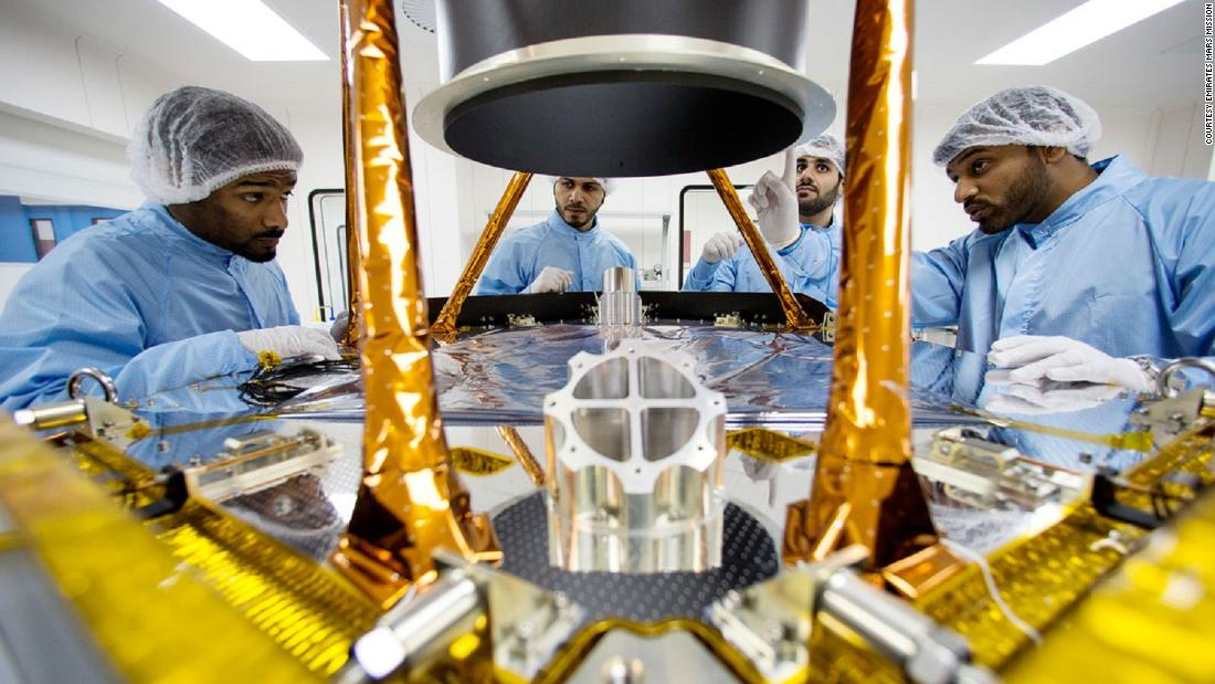 Emirati scientists work on a the Al Amal probe in a lab at the Mohammed Bin Rashid Space Center on the outskirts of Dubai.