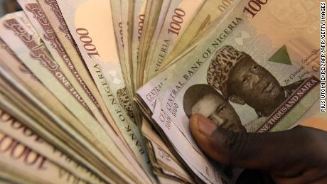 This picture taken on January 29, 2016 in Lagos shows 1000 naira banknotes, Nigeria's currency. Nigeria's central bank governor, Godwin Emefiele, on January 26 dismissed calls to devalue the naira in his monetary policy committee statement. Instead he chose to continue propping up the currency at 197-199 naira to the dollar and maintain foreign-exchange restrictions. As a result, the naira on the black market is hovering around a record low of 305, fuelling complaints from domestic and foreign businesses who can't access dollars required for imports. / AFP / PIUS UTOMI EKPEI (Photo credit should read PIUS UTOMI EKPEI/AFP/Getty Images)