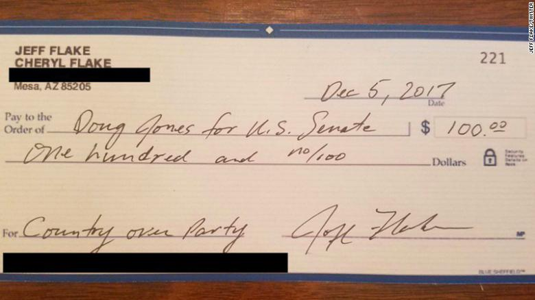 Flake writes check to Democrat opposing Moore