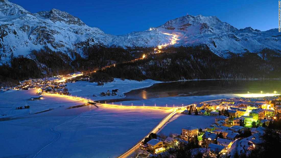 <strong>Light show:</strong> A ski slope is lit up on the Corvastch sector above the village of Silvaplana.