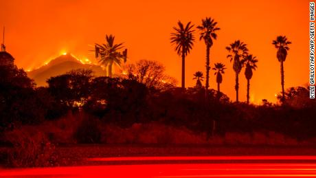 The Thomas Fire burns along a hillside near Santa Paula, California, on December 5, 2017. More than a thousand firefighters were struggling to contain a wind-whipped brush fire in southern California on December 5 that has left at least one person dead, sent thousands fleeing, and was choking the area with thick black smoke. / AFP PHOTO / Kyle Grillot        (Photo credit should read KYLE GRILLOT/AFP/Getty Images)
