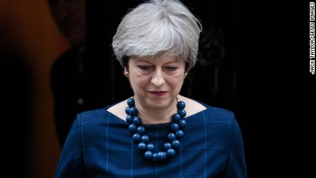 LONDON, ENGLAND - DECEMBER 05: British Prime Minister Theresa May leaves Number 10 to greet Spanish Prime Minister Mariano Rajoy on Downing Street on December 5, 2017 in London, England. Mrs May and Mr Rajoy are expected to discuss the political situation in Catalonia and the ongoing Brexit negotiations. (Photo by Jack Taylor/Getty Images)