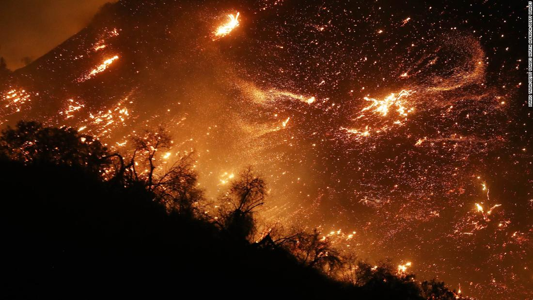 The Creek Fire burns on a hillside in the Shadow Hills neighborhood of Los Angeles on December 5.