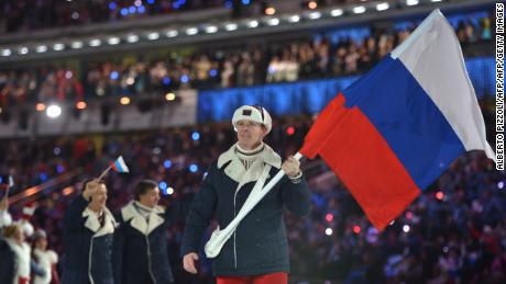 (FILES) This file photo taken on February 07, 2014 shows Russia's flag bearer, bobsledder Alexander Zubkov leading his national delegation during the Opening Ceremony of the Sochi Winter Olympics at the Fisht Olympic Stadium in Sochi. Russia was banned On December 5, 2017 from the 2018 Winter Games by the International Olympic Committee (IOC) over its state-orchestrated doping programme -- something it has always denied -- but clean Russian athletes will be allowed to compete under an Olympic flag. / AFP PHOTO / Alberto PIZZOLIALBERTO PIZZOLI/AFP/Getty Images