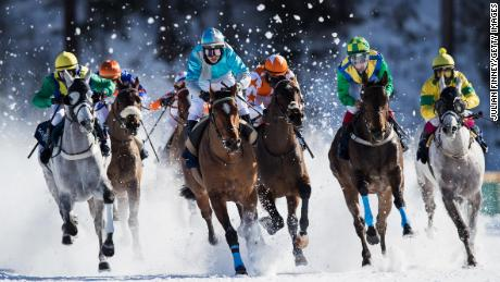 ST MORITZ, SWITZERLAND - FEBRUARY 19:  Guyon Maxime riding Take a Guess (centre) leads the pack in the GP Longines flat race during the White Turf Horse Racing on February 19, 2017 in St Moritz, Switzerland.  (Photo by Julian Finney/Getty Images)
