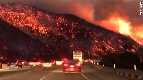 Video shows fire raging near freeway