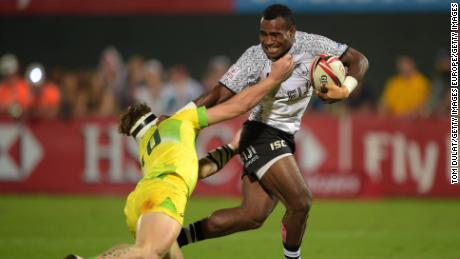 DUBAI, UNITED ARAB EMIRATES - DECEMBER 01:  Jerry Tuwai of Fiji is tackled during the match between Fiji and Australia on Day Two of the Emirates Dubai Rugby Sevens - HSBC Sevens World Series at The Sevens Stadium on December 1, 2017 in Dubai, United Arab Emirates.  (Photo by Tom Dulat/Getty Images)