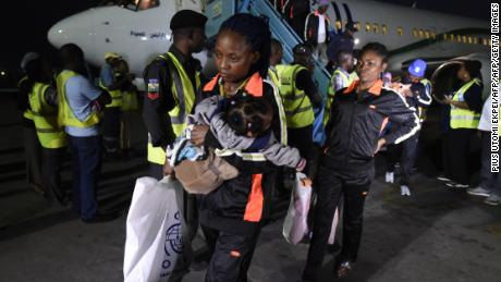A mother and child return home to Lagos along with 150 other migrants from Libya, on December 5, 2017.