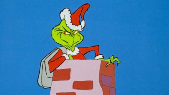 "The Grinch prepares to slide down a chimney in the 1966 version of ""How the Grinch Stole Christmas."""