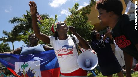 Earlier this year, Haitians marched to keep their protected status at an immigration office in Broward County, Florida.