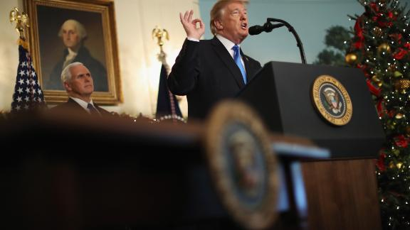 US President Donald Trump announces that the US government will formally recognize Jerusalem as the capital of Israel as Vice President Mike Pence looks on in the Diplomatic Reception Room at the White House December 6, 2017 in Washington, DC. (Photo by Chip Somodevilla/Getty Images)